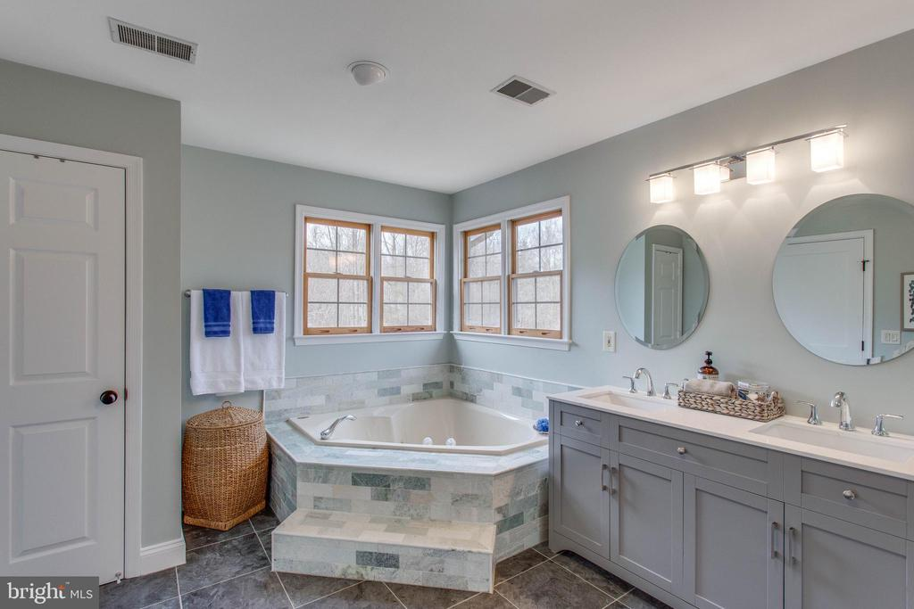 And a second garden tub and double sink vanity. - 12060 ROSE HALL DR, CLIFTON