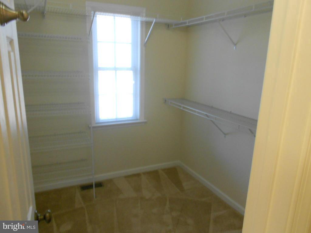 Master bedroom walk-in closet - 11705 WILDERNESS PARK DR, SPOTSYLVANIA