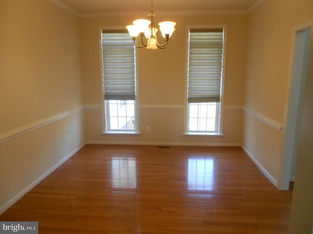 Dining room with hardwood floors & chair rail - 11705 WILDERNESS PARK DR, SPOTSYLVANIA