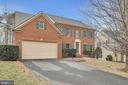 Stately brick front home - 47285 OX BOW CIR, STERLING