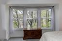 Wooded view from the master bedroom - 7700 LAFAYETTE FOREST DR #23, ANNANDALE