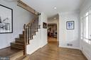 Welcoming foyer with refinished hardwoods. - 6951 GREENTREE RD, BETHESDA