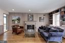 Living room/den w/fireplace adjacent to kitchen. - 6951 GREENTREE RD, BETHESDA