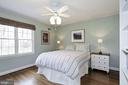 Large second bedroom with huge windows and closet. - 6951 GREENTREE RD, BETHESDA