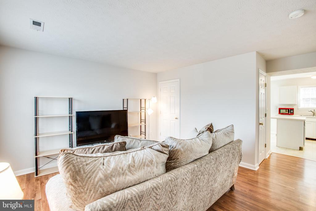 Plenty of natural light and laminate wood floors - 9710 W MIDLAND WAY, FREDERICKSBURG