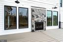 Trex deck w/indoor/outdoor fireplace - 10317 BURKE LAKE RD, FAIRFAX STATION