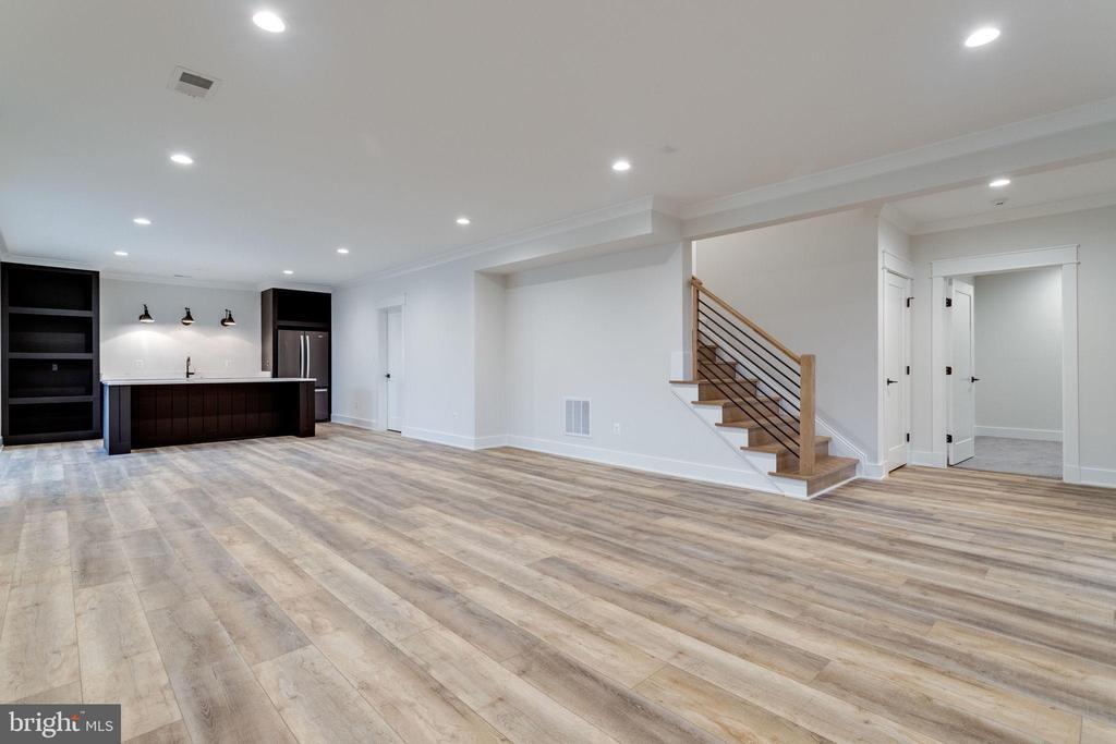 Lower level rec room w/luxury vinyl flooring - 10317 BURKE LAKE RD, FAIRFAX STATION