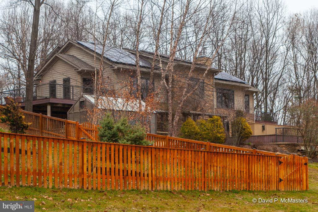 Fenced door yard.  Green house adjacent - 212 CICADA DR, MARTINSBURG