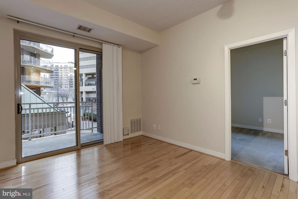 Living Room with Doors leading to Outdoor Balcony - 7500 WOODMONT AVE #S208, BETHESDA