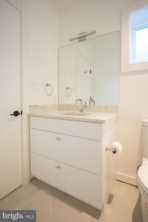 Lower level white vanity, window brings in light - 114 TAPAWINGO RD SW, VIENNA
