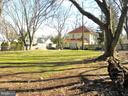 backyard at property edge looking back at the hous - 200 WASHINGTON GROVE LN, GAITHERSBURG