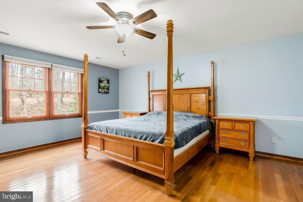 Master bedroom with hardwood floors - 115 GOLD RUSH DR, LOCUST GROVE