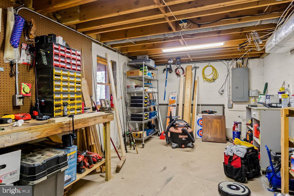 Shop area in the basement. - 115 GOLD RUSH DR, LOCUST GROVE