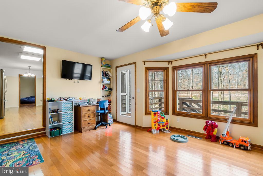 Family room with door ot back deck - 115 GOLD RUSH DR, LOCUST GROVE