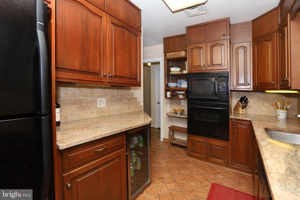 Kitchen with tile flooring, granite countertops - 9020 SOUTHWICK ST, FAIRFAX