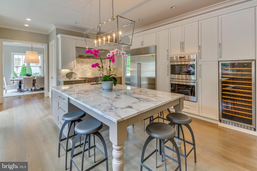 In the center, you'll find the gourmet kitchen... - 11134 STEPHALEE LN, NORTH BETHESDA