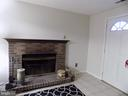 Fireplace on lower level - 3656 WHARF LN, TRIANGLE
