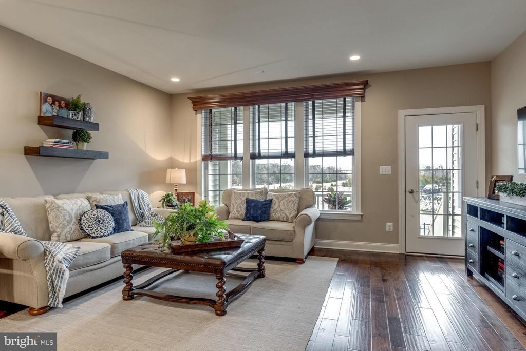 Family room with access to porch. - 44629 GRANITE RUN TER, ASHBURN