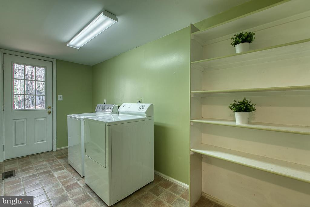 Main level laundry and mud room leading to deck - 3220 TITANIC DR, STAFFORD