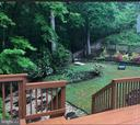 Beautiful view of the back yard in the summertime - 3220 TITANIC DR, STAFFORD