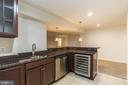 Wet bar with full size dishwasher and wine fridge! - 17156 BELLE ISLE DR, DUMFRIES