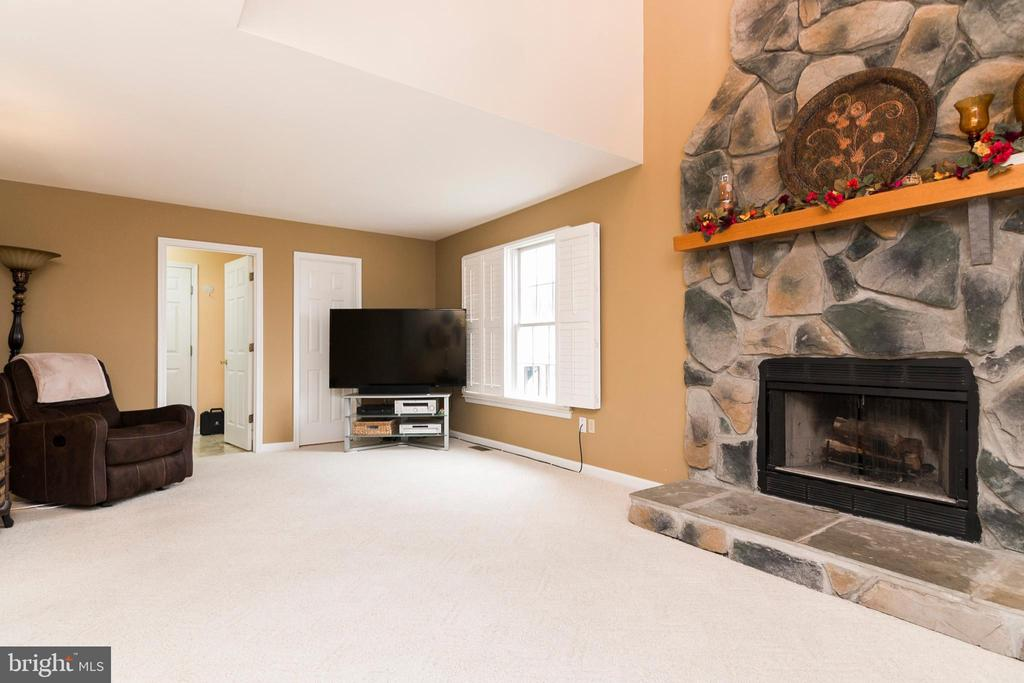 Living Room with Stone Fireplace - 7170 WANDA DR, MOUNT AIRY