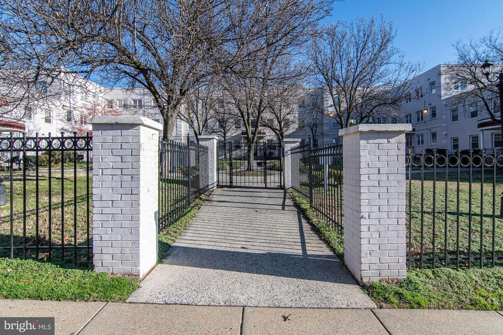 From sidewalk, into gates of gated condominiums - 3872 9TH ST SE #102, WASHINGTON