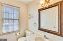main floor 1/2 bath - 4405 CLIFTON SPRING CT, OLNEY
