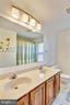 Upper shared bathroom with double vanity - 4405 CLIFTON SPRING CT, OLNEY