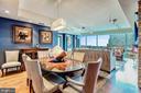 Dining Room Opens to Bright Living Room - 1881 N NASH ST #1211, ARLINGTON
