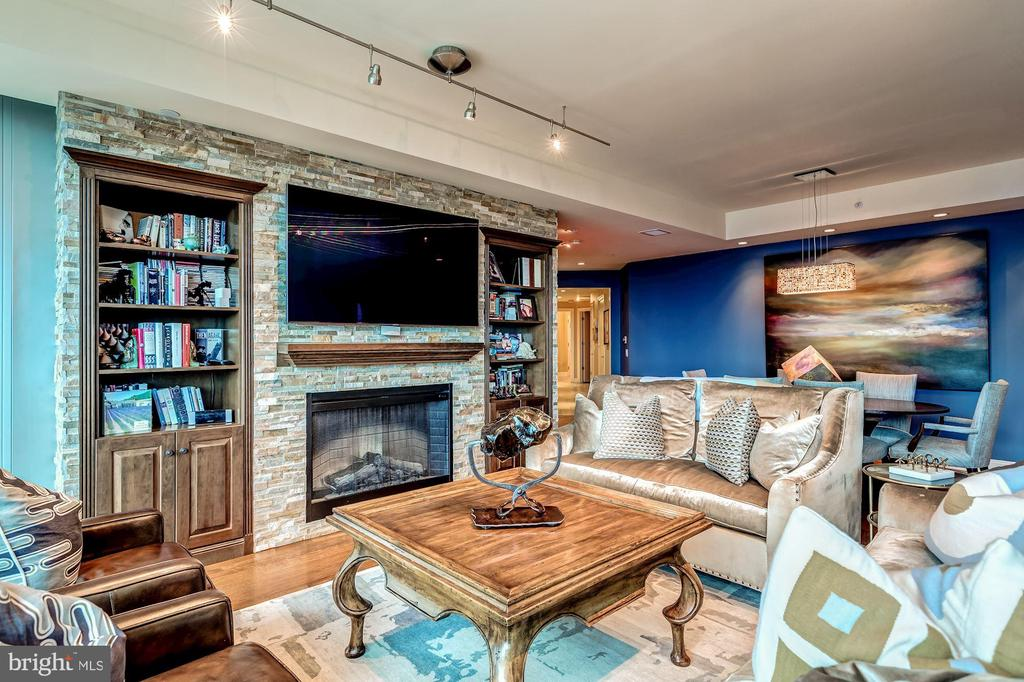 Living Room with Custom Stone Wall and Fireplace - 1881 N NASH ST #1211, ARLINGTON