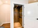Take your private elevator to the second level. - 6103 OLIVET DR, ALEXANDRIA