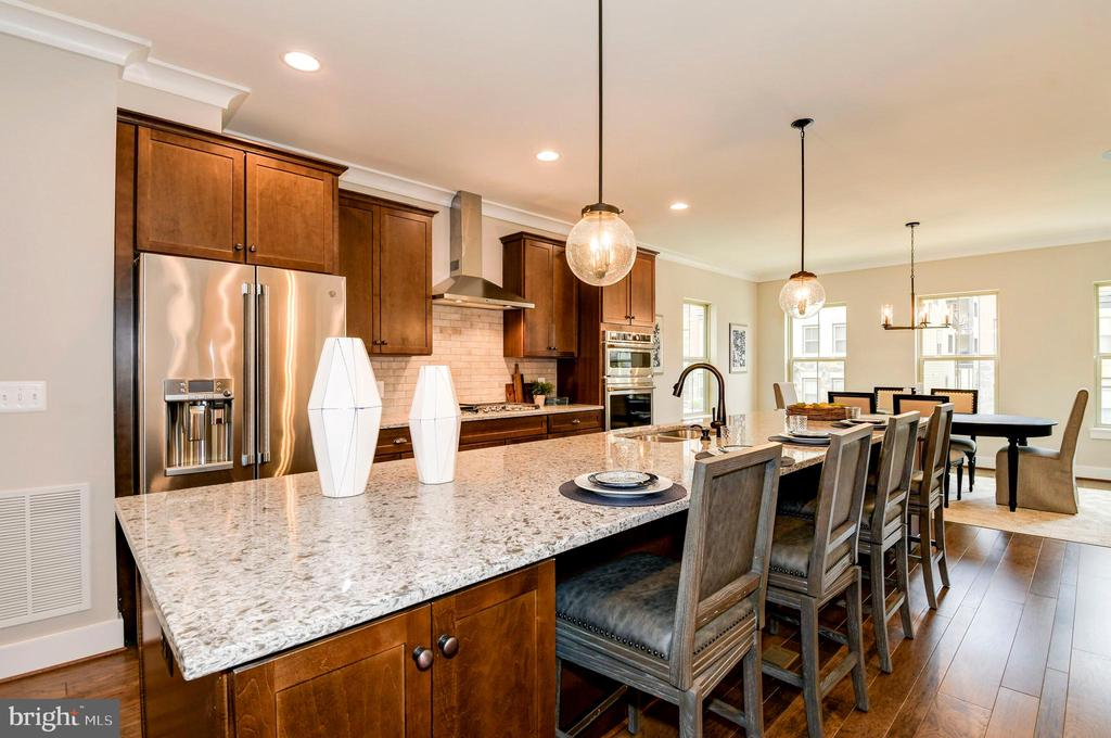 A gorgeous quartz kitchen is the hub of the home. - 6103 OLIVET DR, ALEXANDRIA