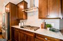 Cooktop with hood and 42 in cabinets. - 6103 OLIVET DR, ALEXANDRIA