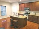 Island kitchen with granite counters - 41909 GALLBERRY TER, ALDIE