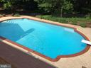 Summer time view of pool - 13701 ESWORTHY RD, GERMANTOWN