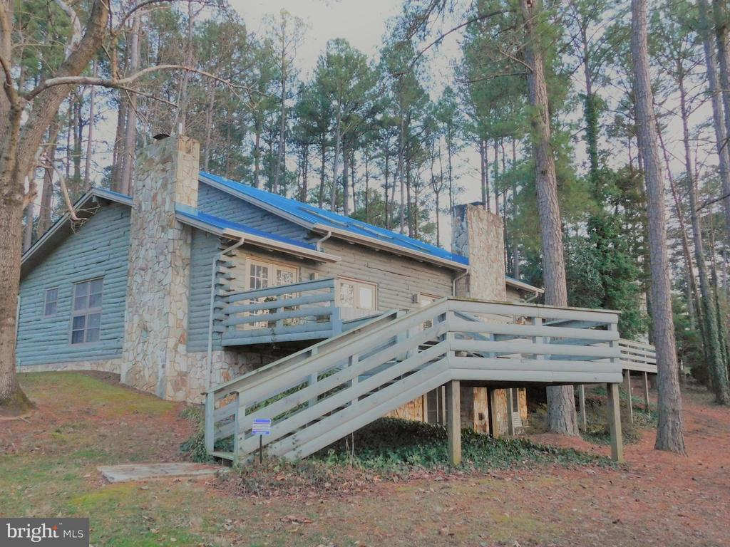Lake-facing side of home, huge multi-tiered deck - 11713 WAYNE LN, BUMPASS