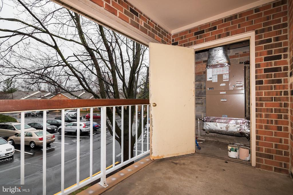 HVAC system in closet on balcony - 5934 COVE LANDING RD #301C, BURKE