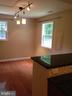 Cottage Dining room with half bath and stack W/D - 437 WINDWOOD LN, PARIS