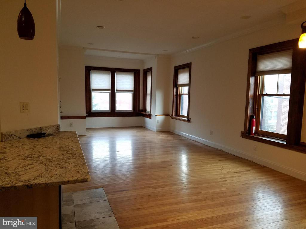 Open living spaces with hardwood floors - 1822 4TH ST NW, WASHINGTON
