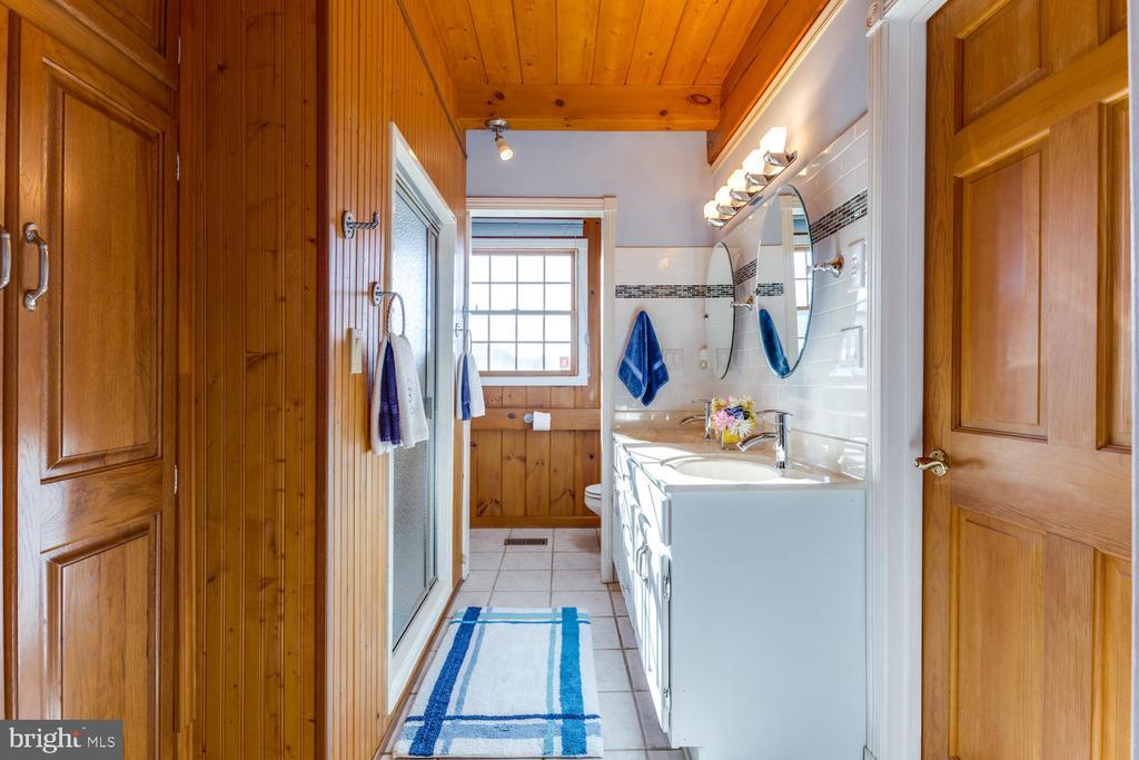 Master Bath has plenty of cabinet space - 15798 LANCASTER FARM RD, NEWBURG