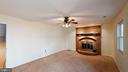 Brick fireplace in basement family room - 56 DOROTHY LN, STAFFORD