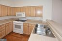 Built-in microwave and smooth surface range - 19375 CYPRESS RIDGE TER #107, LEESBURG