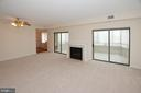 Huge great room with cozy gas fireplace - 19375 CYPRESS RIDGE TER #107, LEESBURG