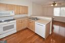 Great kitchen with hardwood flooring - 19375 CYPRESS RIDGE TER #107, LEESBURG