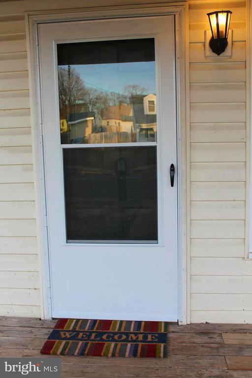 Front door with brand new glass pane storm door - 175 MANASSAS DR, MANASSAS PARK