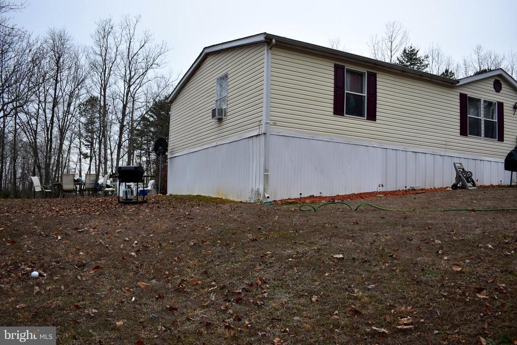 Side Of House Looking Towards Backyard - 34296 INDIANTOWN RD, LOCUST GROVE