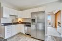 White cabinets with granite counter tops. - 4141 N HENDERSON RD #1011, ARLINGTON