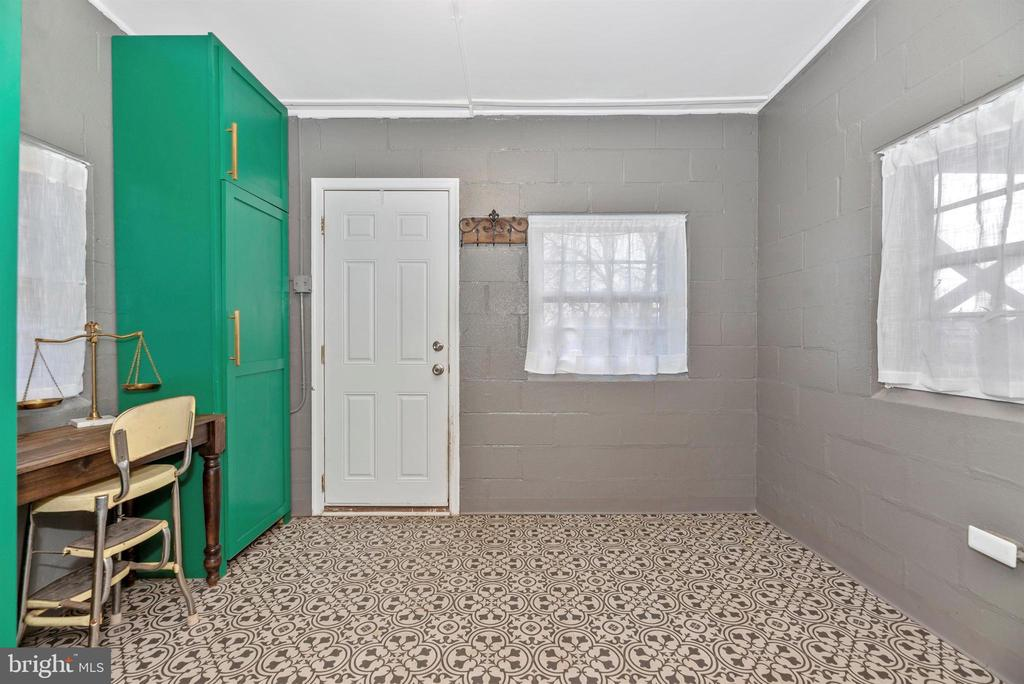 Mud Room with Laundry and exposed Brick wall - 10 N WISNER ST, FREDERICK