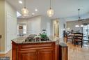 ISLAND WITH PENDANT LIGHTS - 5014 QUELL CT, WOODBRIDGE